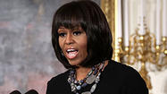 First lady Michelle Obama will return to Chicago next week as part of a nationwide tour to promote her children's obesity prevention campaign and reveal plans to increase physical activity at schools.