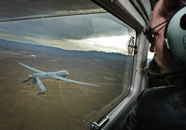 Pilot Mark Bernhardt keeps an eye on a Predator unmanned drone from his chase plane as they fly over Victorville.