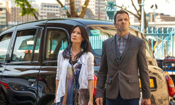 "A philanthropist suspects he was intentionally infected with an incurable illness on ""Elementary"" at 10 p.m. on CBS. With Jonny Lee Miller, left, Lucy Liu and Aidan Quinn."