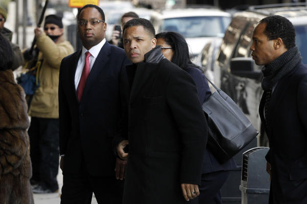 Former Rep. Jesse Jackson Jr., center, enters federal court in Washington, D.C.