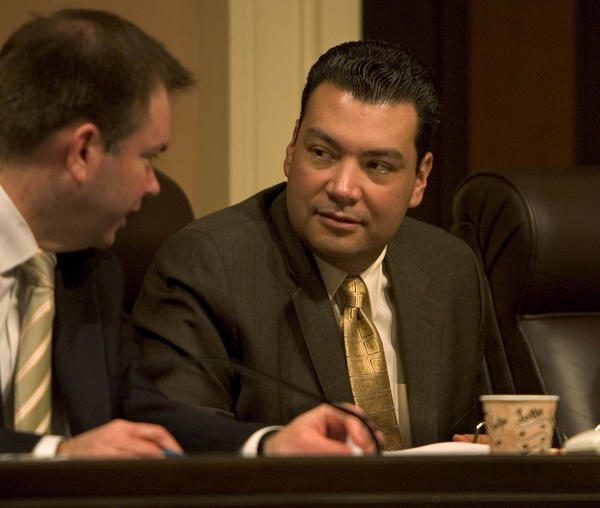 State Senator Alex Padilla (DPacoima), center, listens to a staffer during a Rules Committee hearing in the state Capitol.