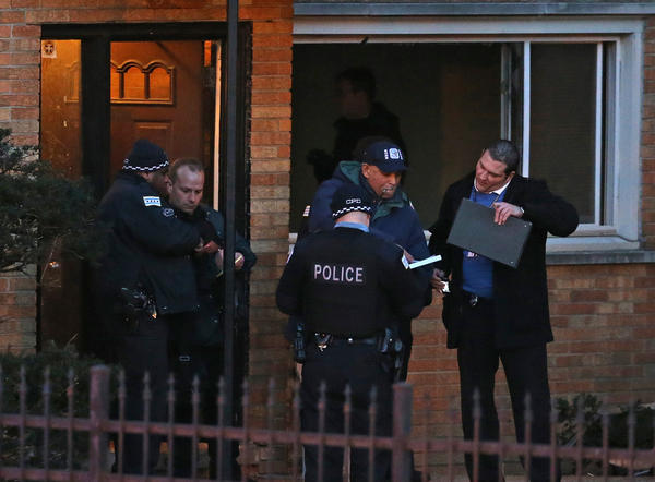 Chicago police personnel and members of the FBI investigating the scene of a fire in the 8100 block of S. Maryland, in Chicago. Two bodies were discovered at the scene.