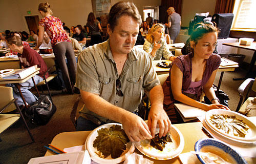 Joe Lewis, left, a North Hollywood High teacher, makes dolmas in a class.