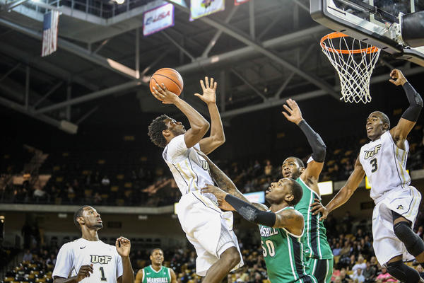 UCF's Daiquan Walker (4) goes up to shoot during first half action of a NCAA basketball game against the Marshall at the UCF Arena in Orlando