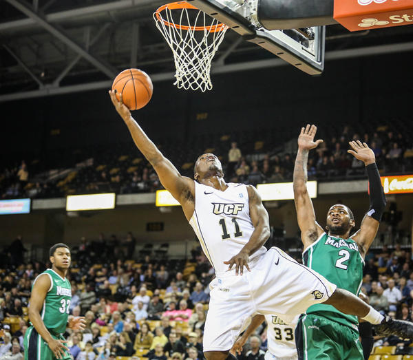 UCF's Calvin Newell (11) goes up for a layup during first half action of a NCAA basketball game against the Marshall at the UCF Arena in Orlando