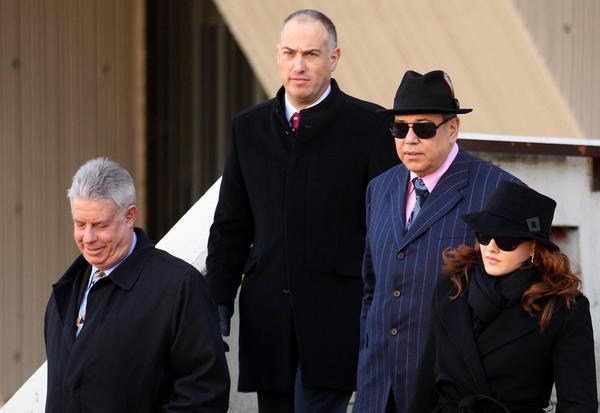 (Left to right) Retired judge and witness Daniel Locallo joins defense attorneys Steve Greenberg, Joe Lopez and Lisa Lopez, as the hearing on a motion for a new Drew Peterson trial broke for lunch at the Will County Courthouse in Joliet, Ill.