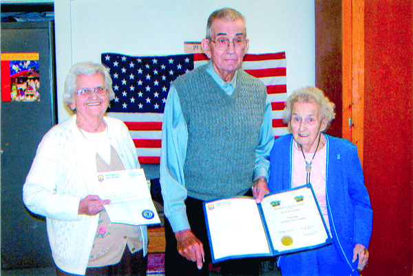 Betty Jean Hauger-Gerhold, right, was honored for 75 years membership in the Wills Grange while Elmira Jane Knepper, left, received her 65-year membership seal. The presentations were made by former Pennsylvania State Grange Master William H. Ringler, who has also been a member of Wills Grange since 1944. Unable to attend was Wilmer L. Coughenour, a recipient of a 60-year seal for his Golden Sheaf certificate.