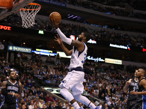 Dallas Mavericks guard O.J. Mayo (32) shoots against the Orlando Magic at the American Airlines Center.