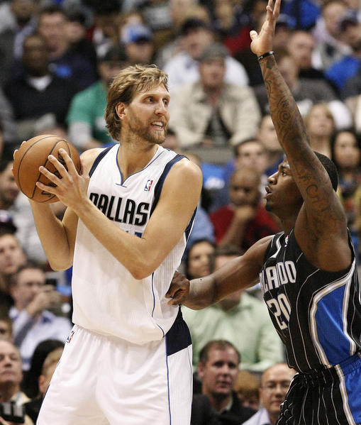 The Dallas Mavericks' Dirk Nowitzki looks for room against the Orlando Magic's forward DeQuan Jones (20) during the first half at the American Airlines Center in Dallas, Texas