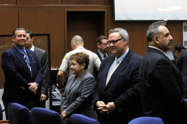 Former Bell City Council members Luis Artiga, left, Teresa Jacobo, George Mirabal, George Cole and former Mayor Oscar Hernandez stand as the jury leaves the courtroom for lunch on Wednesday. Closing arguments were underway.