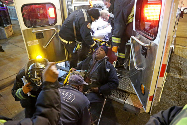 A CTA train operator is placed in an ambulance at the CTA Red Line station at Chicago Avenue and State Street in Chicago after another person was rescued from the tracks.