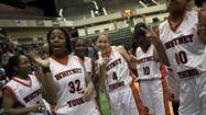 Young players celebrate after defeating Morgan Park at Chicago State University  earlier this season.