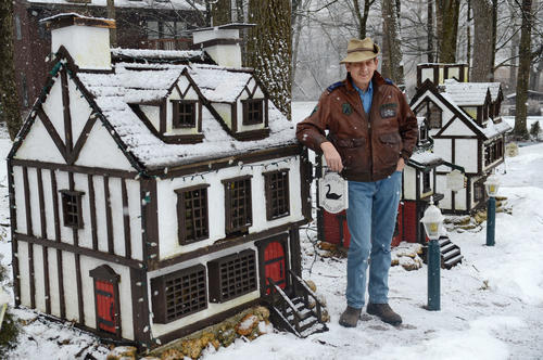 Bill Shimkus stands next miniature houses he built himself that sit in his front yard in Orefield and garner a lot of attention from passerby's.
