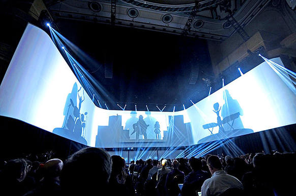 Computer graphic icons for the new Sony PlayStation 4 are displayed on a three-sided screen at their launch event in New York.