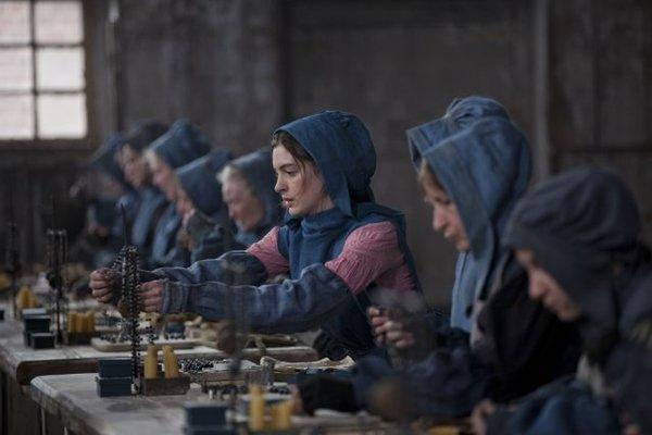 """Anne Hathaway, center, as Fantine in """"Les Miserables."""""""