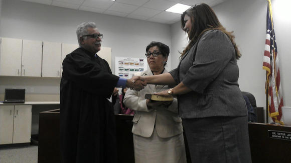 Juanita Salas (right) is sworn in by Superior Court Judge Juan Ulloa