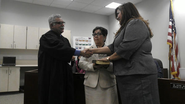 Juanita Salas (right) is sworn in by Superior Court Judge Juan Ulloa as a member of the Imperial Valley College Board of Education in Imperial on Wednesday.