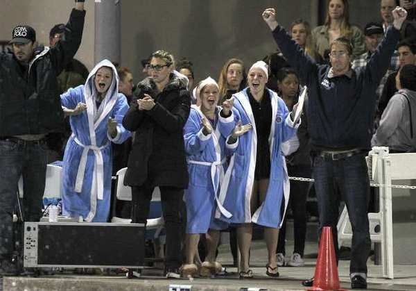 Corona del Mar High head coach Sam Bailey, far right, reacts to his team defeating Foothill.