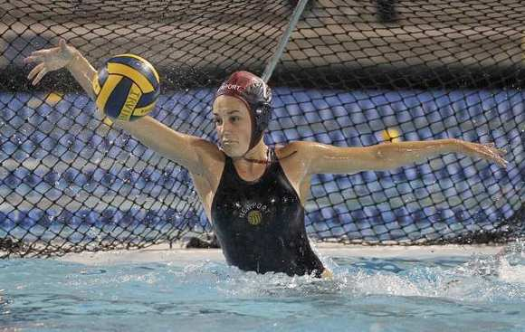 Newport Harbor High goalie Cleo Harrington blocks a shot for one of her 13 saves against Santa Barbara.