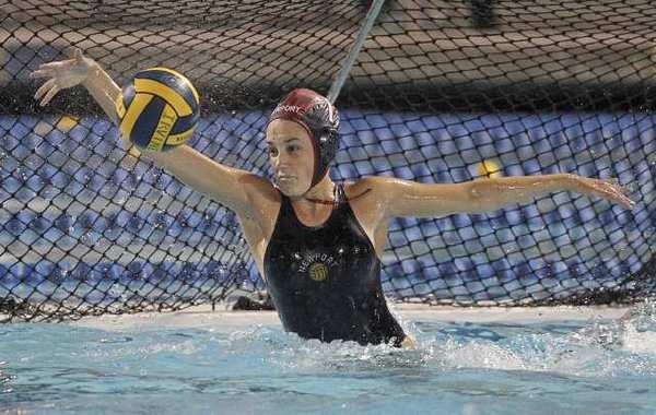Newport Harbor High goalie Cleo Harrington blocks a shot for one of her 13 saves against Santa Barbara.