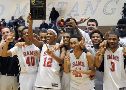 The Edgewood Rams boys basketball team celebrates after their win over Joppatowne in Wednesday night's UCBAC championship game at C. Milton Wright High.