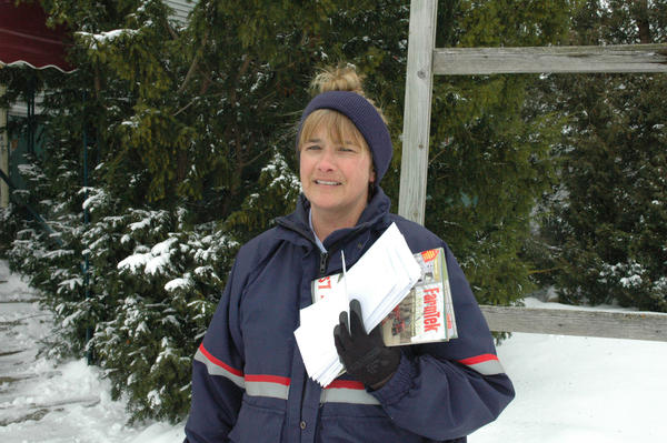 Lisa Muszynski is a mail carrier for the United States Postal Service office in Petoskey.