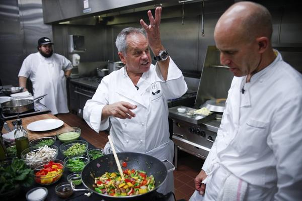 Wolfgang Puck will have a busy Sunday.