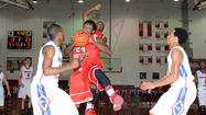 George Rogers Clark forward Khamarkis Blanton drives to the basket during the first half of the Cardinals¿ 66-42 loss to Montgomery County in the finals of the 40th District Tournament Wednesday night at Norton Gymnasium.