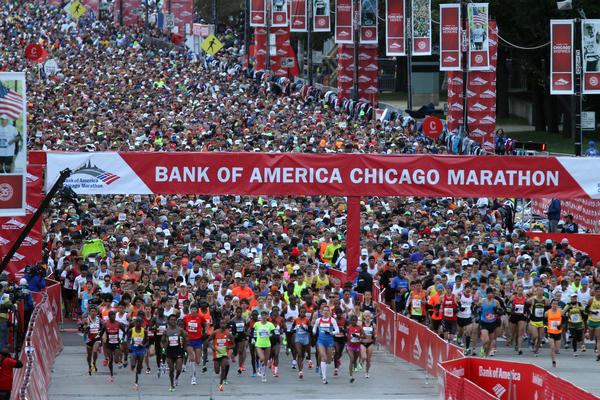 The elite runners leave the starting line on Columbus Drive at the start of the 2012 Bank of America Chicago Marathon.