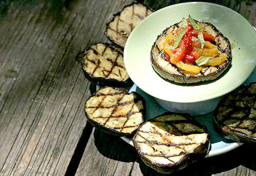 Thick slices of eggplant brushed with olive oil capture a grill's smokiness, while slow-roasted red and yellow peppers add a sweet dimension.
