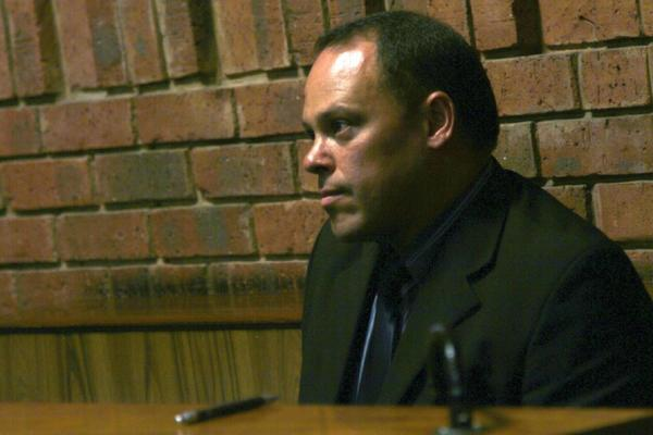 Hilton Botha was replaced as the lead investigator in the murder case against Oscar Pistorius when it was found he had attempted murder charges brought against him.