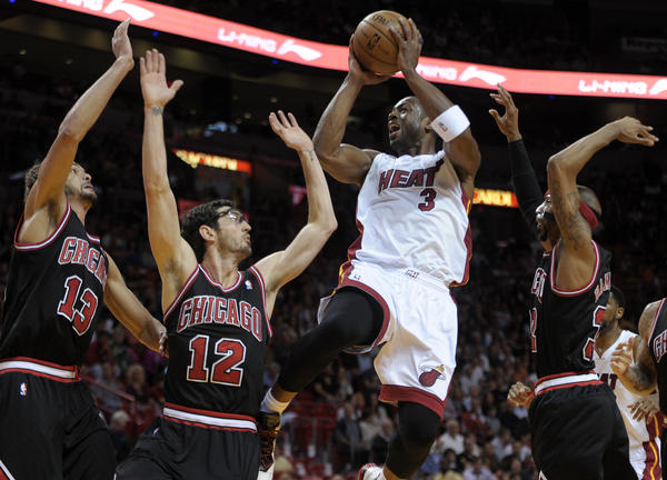 Miami Heat guard Dwyane Wade scores over four Bulls defenders during the first half of their game on Jan. 4.