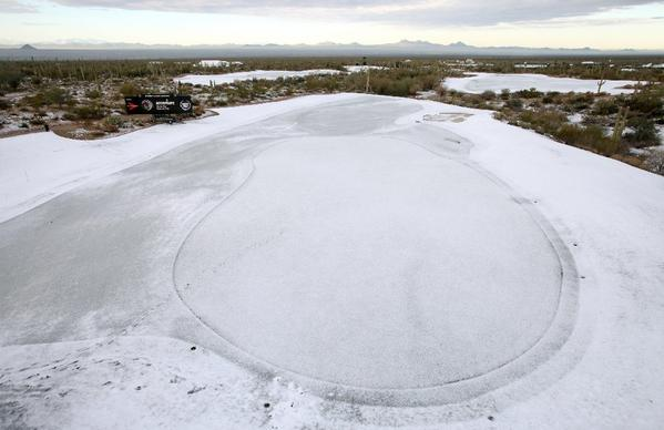 Snow and frost cover the No. 9 green Thursday in Marana, Ariz.