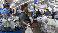Wal-Mart: Tax refund delay, high gas prices to flatten sales