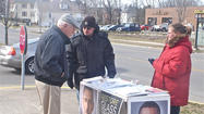 "Representatives of fringe political candidate Lyndon LaRouche brought their ""Impeach Obama"" show to Danville on Wednesday, drawing roughly equal numbers of jeers and cheers from those who passed by their table set up on East Main Street in front of the post office."