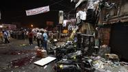 NEW DELHI — At least 11 people were killed and 75 wounded when twin blasts struck a busy bus terminal, market and theater district Thursday in the southern Indian city of Hyderabad.