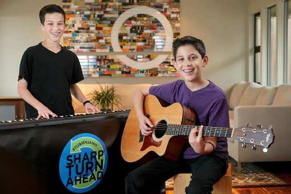 Twin brothers Kyle Sharp, right, and Benjamin Sharp, left, both 13, at their home in Laguna Beach. The band duo performs regularly at the Irvine Spectrum.