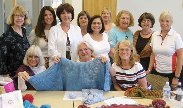 Laguna Beach Community Foundation distributed a donation to the Laguna Beach Seniors from the Crevier Family Donor Advised Fund. The Susi Q Knitting Group volunteers make shawls and lap blankets for oncology patients at Mission Hospital.