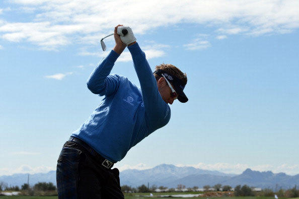 Ian Poulter of England warms up on the range as he awaits the start of the continuation of the first round of the World Golf Championships - Accenture Match Play at the Golf Club at Dove Mountain on February 21, 2013 in Marana, Arizona.