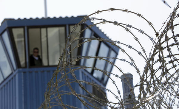 About 1,200 inmates are being held in segregation at Pelican Bay State Prison alone. Above, a guard tower at the prison, seen behind concertina wire.