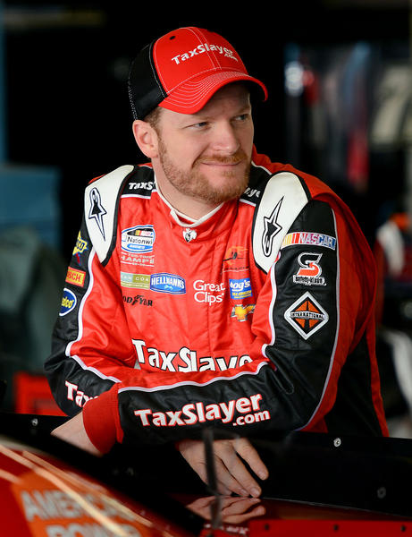 NASCAR Nationwide Series driver (88) Dale Earnhardt Jr. waits in the garage next to his TaxSlayer.com Chevrolet waiting for the start of practice on Thursday, February 21, 2013 at Daytona International Speedway in Daytona Beach, Florida.
