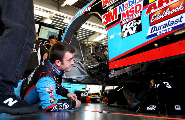 Austin Dillon, driver of the #3 AdvoCare Chevrolet, looks under his car in the garge during practice for the NASCAR Nationwide Series DRIVE4COPD 300 at Daytona International Speedway on February 21, 2013 in Daytona Beach, Florida.