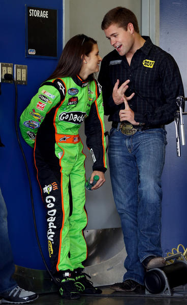 Danica Patrick (L), driver of the #34 GoDaddy.com Chevrolet, talks with Cup Series Ricky Stenhouse Jr. (R), driver of the #17 Best Buy Ford, in the garage during practice for the NASCAR Nationwide Series DRIVE4COPD 300 at Daytona International Speedway on February 21, 2013 in Daytona Beach, Florida.