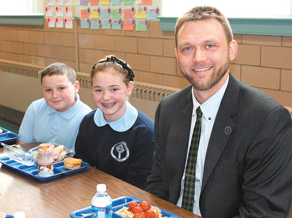 Hagerstown Mayor David S. Gysberts, right, is pictured with St. Mary Catholic School fifth-graders Sofia Corsi, center, and Del Carden at lunch.