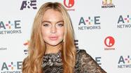 "There's a <a href=""http://www.usmagazine.com/celebrity-style/news/lindsay-lohan-returns-borrowed-1750-designer-dress-in-tatters-pictures-2013202"">report out of US Weekly</a> that <a href=""http://people.zap2it.com/p/lindsay-lohan/86647"">Lindsay Lohan</a> may have taken some scissors to a borrowed designer THEIA dress after an American Foundation for AIDS Research event in New York City during Fashion Week."