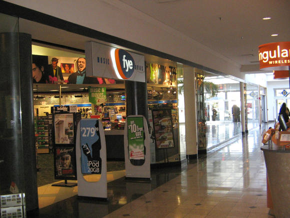F.Y.E., which once operated this shop at Coliseum Mall, plans to close another s