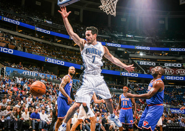 Magic guard J.J. Redick (7) is fouled by New York's Raymond Felton (2) during first quarter action of a game against the New York Knicks at Amway Center in Orlando, Fla. on Tuesday November 13, 2012.