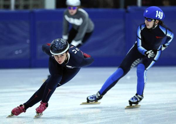 Three-time Olympian and bronze medalist speedskater Allison Baver, left, practices for a competition at the Midland Civic Arena in Midland, Mich.
