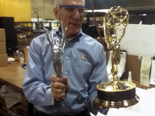 R.S. Owens company president Scott Siegel holds a newly molded Emmy award next to the finished product.