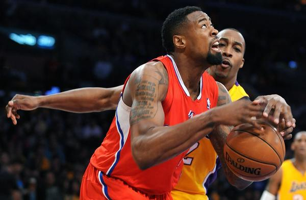 Center DeAndre Jordan, driving to the basket against Lakers center Dwight Howard last week, will remain with the Clippers as they push for a top-four seeding in the Western Conference playoffs.